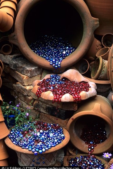 Glass beads spilling out of Whichford Pottery